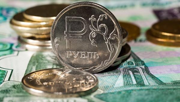 Российский рубль днем корректируется вниз к евро и стабилен к доллару